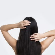 woman touching her hair